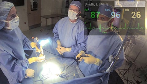 OR room as seen while wearing Google Glass.  Patient vital signs show while watching the procedure.